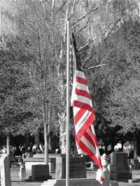 American flag (color) and historic cemetery (black and white)