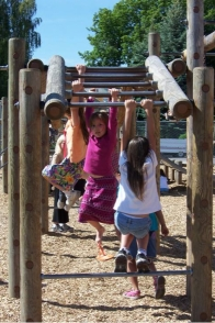 Little girls playing on monkey bars Opens in new window